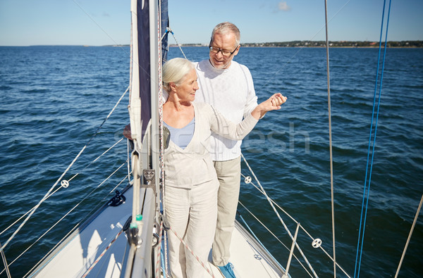 senior couple hugging on sail boat or yacht in sea Stock photo © dolgachov