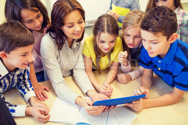 Stock photo: group of kids with teacher and tablet pc at school