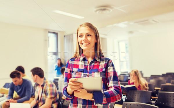 Csoport mosolyog diákok táblagép oktatás középiskola Stock fotó © dolgachov