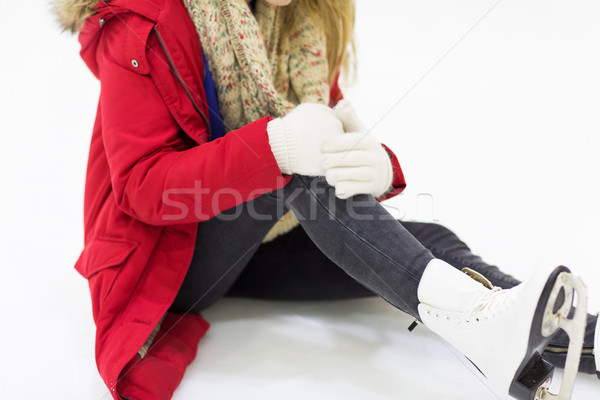 young woman with knee trauma on skating rink Stock photo © dolgachov