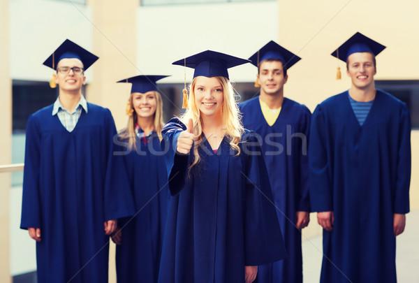 Csoport mosolyog diákok oktatás érettségi kézmozdulat Stock fotó © dolgachov