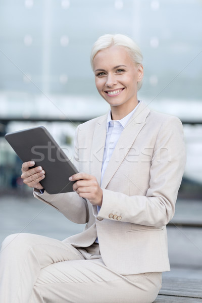 Stock photo: smiling businesswoman with tablet pc outdoors