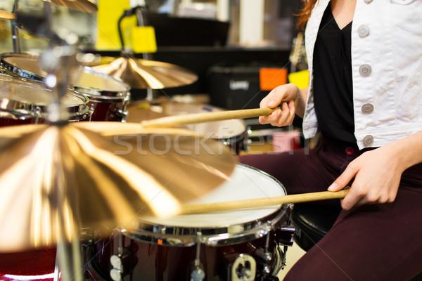 close up of woman playing cymbals at music store Stock photo © dolgachov