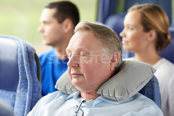 senior man sleeping in travel bus with neck pillow Stock photo © dolgachov