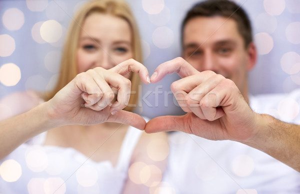 close up of couple showing heart with hands Stock photo © dolgachov