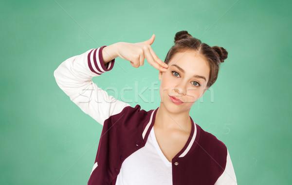 Entediado estudante menina dedo pistola Foto stock © dolgachov