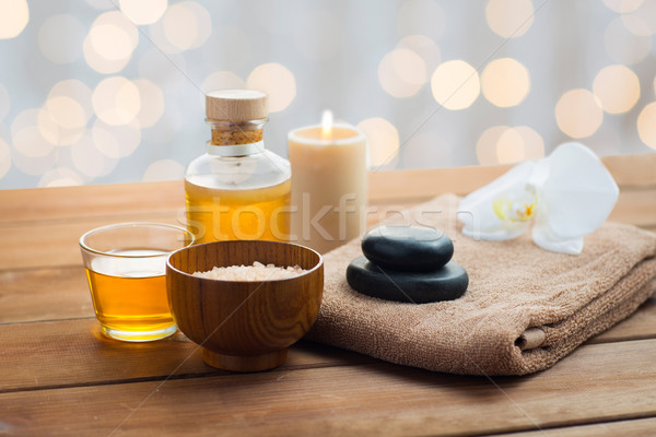 close up of salt, massage oil and bath stuff Stock photo © dolgachov