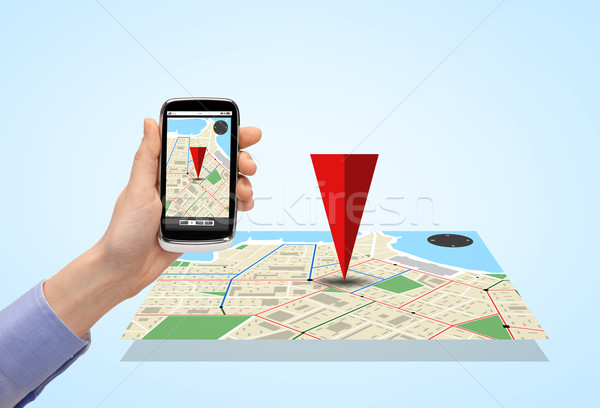 close up of hand with smartphone gps navigator map Stock photo © dolgachov