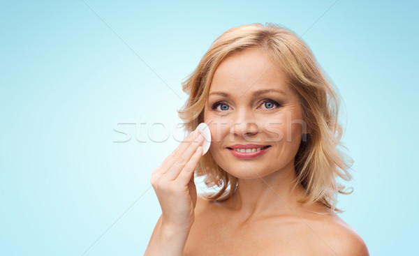 happy woman cleaning face with cotton pad Stock photo © dolgachov