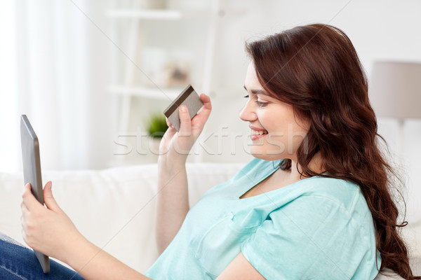 plus size woman with tablet pc and credit card Stock photo © dolgachov