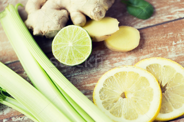 close up of ginger, celery and lemon on table Stock photo © dolgachov