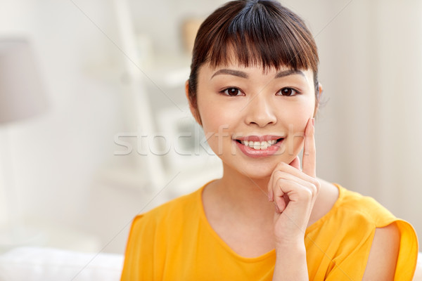 happy asian young woman at home Stock photo © dolgachov