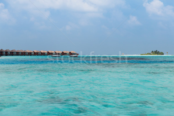Bungalow mar agua exótico Resort playa Foto stock © dolgachov