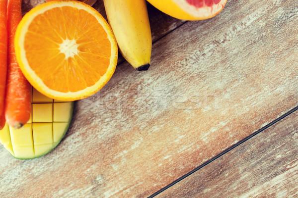 close up of fresh juicy fruits on table Stock photo © dolgachov