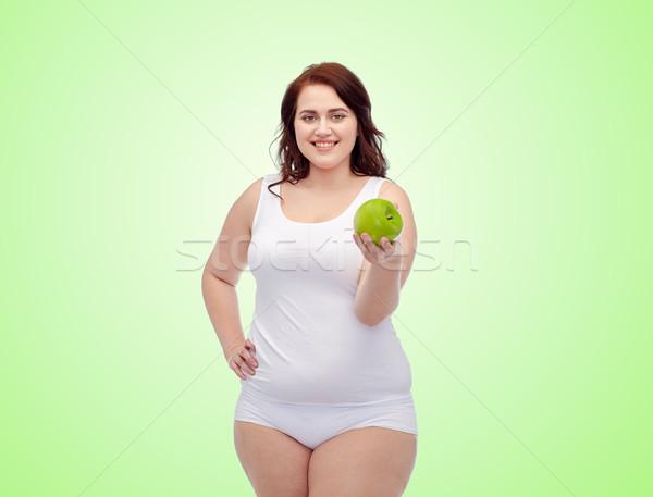 happy plus size woman in underwear with apple Stock photo © dolgachov