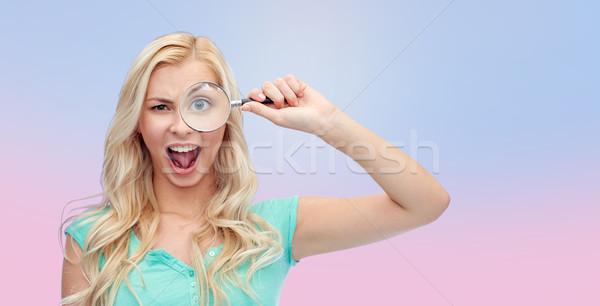 Gelukkig jonge vrouw vergrootglas visie exploratie onderzoek Stockfoto © dolgachov