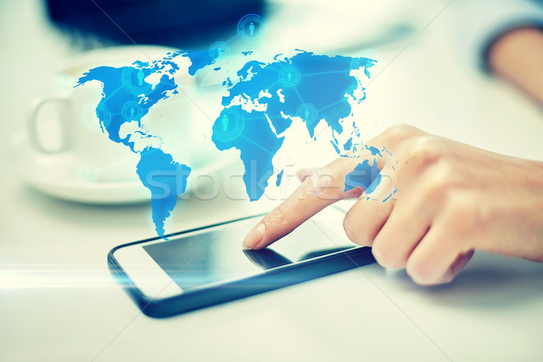 close up of woman hand with smartphone and map Stock photo © dolgachov
