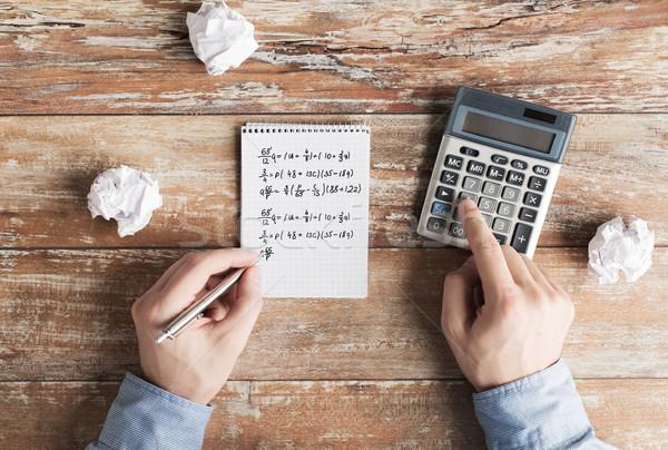 Handen calculator taak business onderwijs Stockfoto © dolgachov
