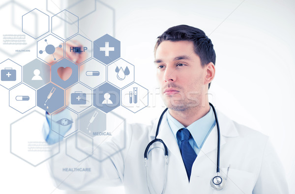 doctor with stethoscope and virtual screen Stock photo © dolgachov