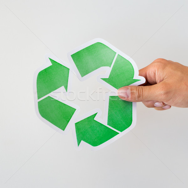 close up of hand holding green recycle symbol Stock photo © dolgachov