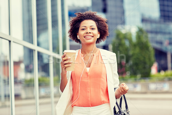 happy african businesswoman with coffee in city Stock photo © dolgachov