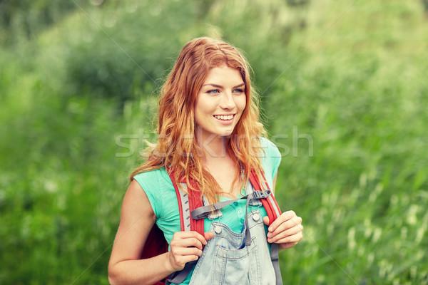 Uśmiechnięty młoda kobieta plecak turystyka lesie przygoda Zdjęcia stock © dolgachov