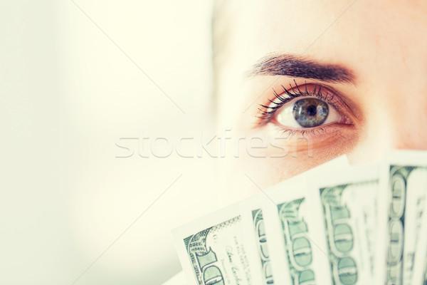 woman hiding her face behind us dollar money fan Stock photo © dolgachov