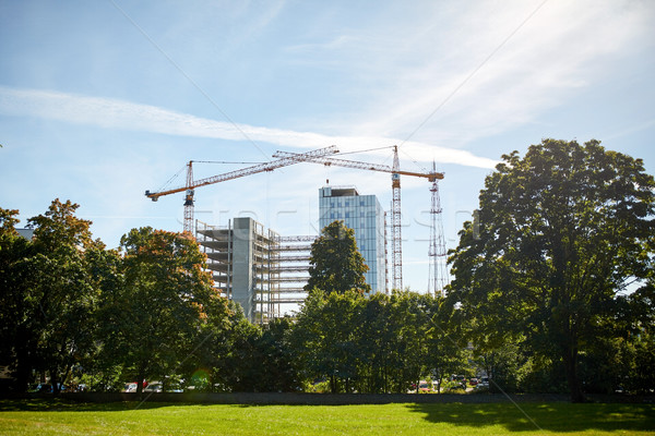 crane at construction site building living house Stock photo © dolgachov