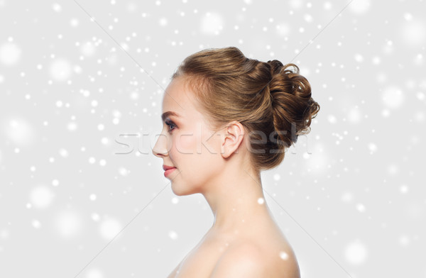 beautiful young woman face over snow Stock photo © dolgachov