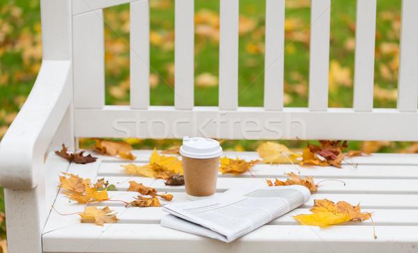 újság kávéscsésze pad ősz park évszak Stock fotó © dolgachov