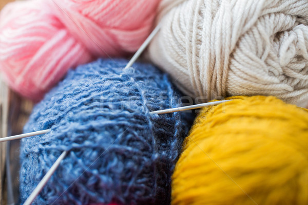 close up of knitting needles and yarn balls Stock photo © dolgachov
