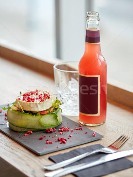Salata şişe içmek cam çatal bıçak takımı tablo Stok fotoğraf © dolgachov