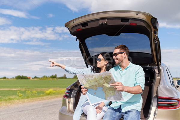 happy man and woman with road map at hatchback car Stock photo © dolgachov