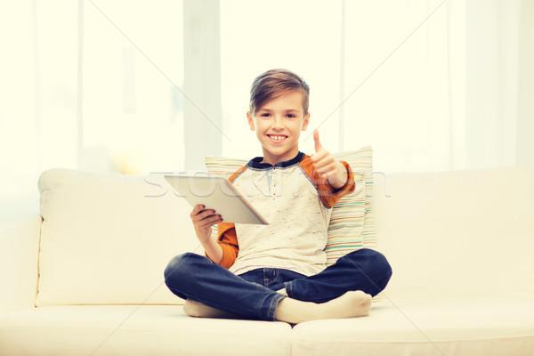 Stockfoto: Glimlachend · jongen · tablet · tonen · home