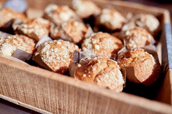 close up of muffins in wooden box Stock photo © dolgachov
