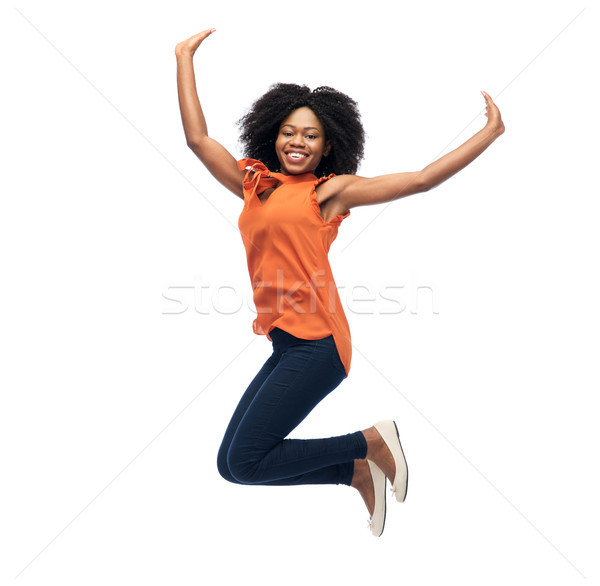 Szczęśliwy kobieta skoki biali ludzie wyścigu Zdjęcia stock © dolgachov