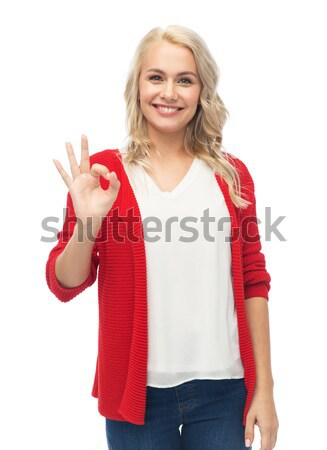 Feliz sorridente mulher jovem sinal da mão Foto stock © dolgachov