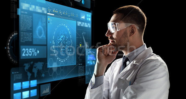 Stock photo: scientist in goggles looking at virtual screen