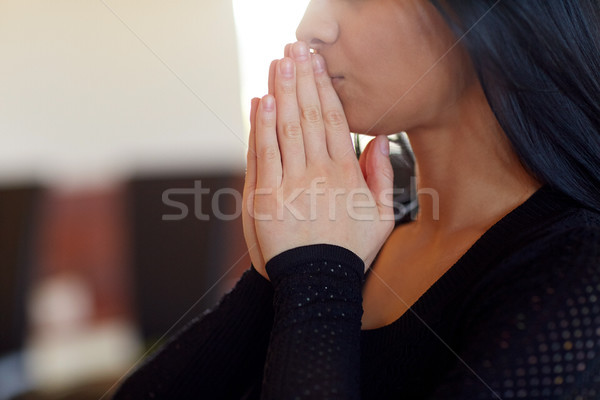 close up of sad woman praying god in church Stock photo © dolgachov
