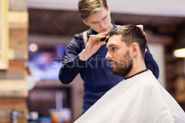 Adam berber saç insanlar tarak Stok fotoğraf © dolgachov