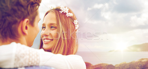 happy smiling young hippie couple over sea Stock photo © dolgachov