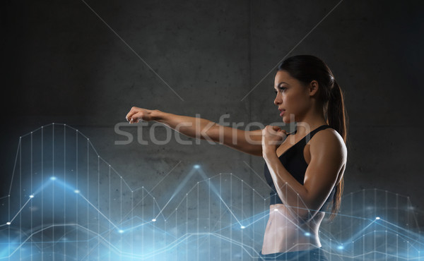 woman boxing in gym Stock photo © dolgachov
