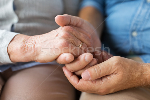 close up of senior couple holding hands Stock photo © dolgachov