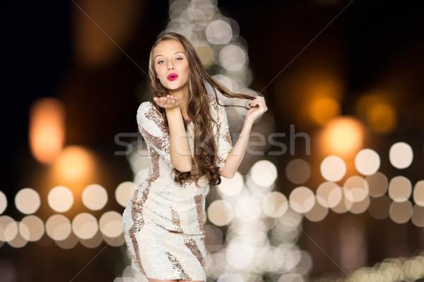 Feliz mujer aire beso Navidad Foto stock © dolgachov