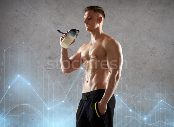 young man or bodybuilder with protein shake bottle Stock photo © dolgachov