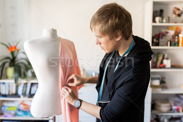 fashion designer with dummy making dress at studio Stock photo © dolgachov
