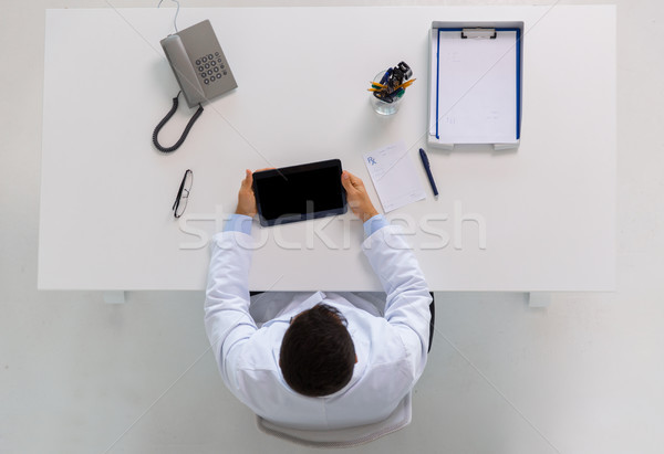doctor with tablet pc and prescription at clinic Stock photo © dolgachov