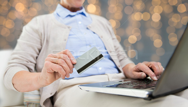 senior woman with laptop and credit card Stock photo © dolgachov