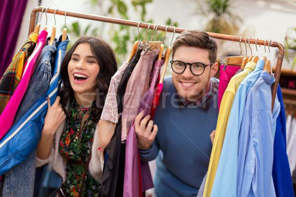 happy couple having fun at vintage clothing store Stock photo © dolgachov