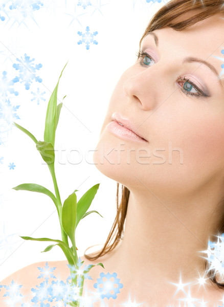 blue-eyed brunette with bamboo Stock photo © dolgachov